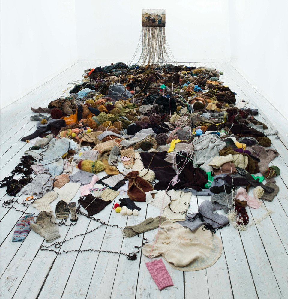 """After The Market"" 2009. Installation, unravelled knitted wool clothes / knitted image after the painting The Gleaners  (1857) Jean-Francois Millet. Photo: M.Tomaszewicz. Courtesy: The National Museum of Art, Architecture and Design, Norway."
